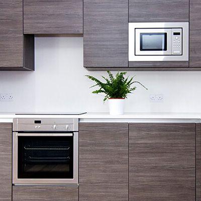 Integrerte hvitevarer på kjøkkenet er stilig